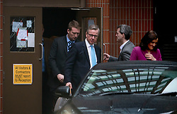 © Licensed to London News Pictures. 20/02/2016. London, UK. MICHAEL GOVE MP and THERESA VILLIERS leaving a 'Vote Leave' meeting in Westminster via a back door after announcing they will vote against UK membership of the EU. Photo credit: Ben Cawthra/LNP