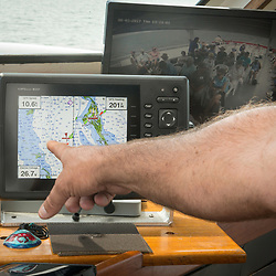 August 4, 2017 - Captain  Stephen Thomas looks at his GPS radar focused on teh Chesapeake Bay en route to Tangier Island. Photo by Susana Raab/Institute