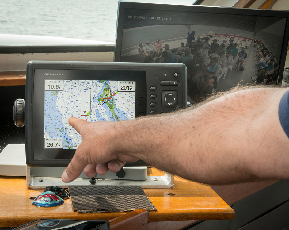 August 4, 2017 - Captain  Stephen Thomas looks at his GPS radar focused on teh Chesapeake Bay en route to Tangier Island. Photo by Susana Raab/Institute