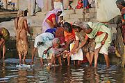 Women wash and perform rituals at the Dashashwamedh Ghat, Varansi, India. Varanasi, India.