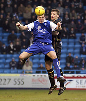 Picture: Henry Browne.<br /> Date: 26/02/2005.<br /> Gillingham v Wigan Athletic Coca Cola Championship.<br /> Darius Henderson of Gills wins a header over Matt Jackson of Wigan.