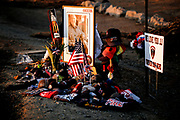 A memorial for firefighter Jeremy Stoke, 37, is seen along Buenaventura Boulevard on Tuesday, Aug. 28, 2018, in Redding, Calif. Stoke was helping residents evacuate in west Redding when he became entrapped by a massive fire tornado as the Carr Fire tore through the city on July 26, killing him.