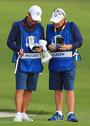 The caddies of Team Europe's Rory McIlroy and Thorbjorn Olesen compare score cards during the Fourballs match on day one of the Ryder Cup at Le Golf National, Saint-Quentin-en-Yvelines, Paris.
