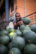 A Sri Lankan man offloads a delivery of watermelons at the Dambulla wholesale produce market in Dambulla, Sri Lanka.