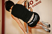 Paris, France. October 9th 2007.A Pole Dance class at the ArtStrip School.. .ArtStrip School.Studio 50 .193 Rue du Faubourg Poissonnière.75019 Paris.