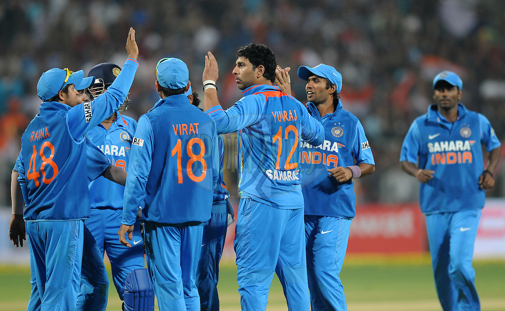 Yuvraj Singh of India celebrates the wicket of Eoin Morgan captain of England with teammates during the first Airtel T20 Match between India and England held at Subrata Roy Sahara stadium in Pune on the  20th December 2012..Photo by  Pal Pillai/BCCI/SPORTZPICS .