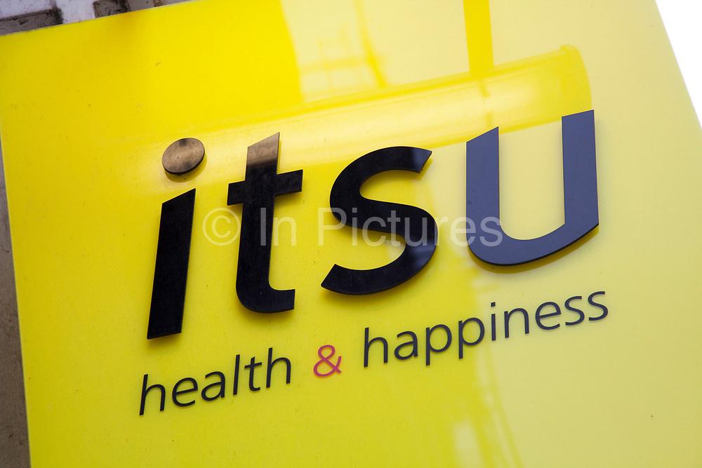 Sign for Itsu japanese sushi and salad bar.