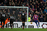 Luka Milivojevic of Crystal Palace (R) scores his team's first goal from a penalty. Premier League match, Crystal Palace v Newcastle Uutd at Selhurst Park in London on Sunday 4th February 2018. pic by Steffan Bowen, Andrew Orchard sports photography.