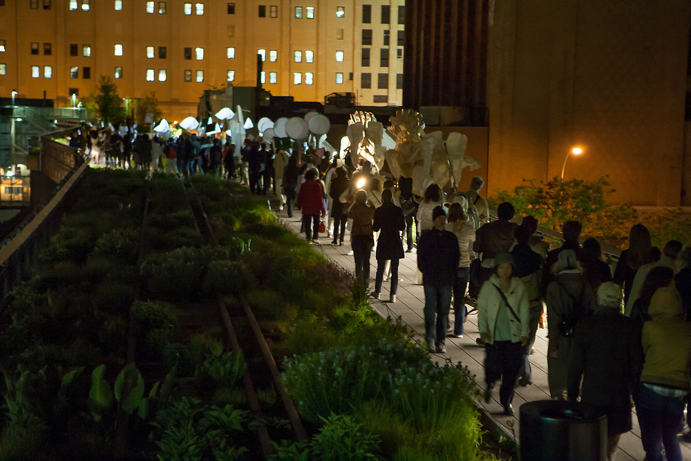 New York, NY - 30 April 2012. The parade passes 20th Street, on its way from 30th Street to Gansevoort Street. Some of the old railroad tracks can be seen amidst the greenery.