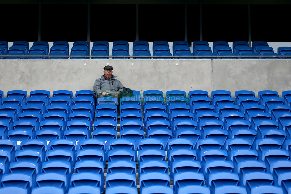 A Cardiff City fan in the stands before the match begins