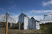 The Church in 'the Jungle' migrant camp in Calais, France, August 10, 2015. The Calais jungle is the nickname given to a series of camps in the vicinity of Calais, France, where migrants live while they attempt to enter the United Kingdom illegally by stowing away on lorries, ferries, cars, or trains travelling through the Port of Calais or the Eurotunnel Calais Terminal. The migrants are a mix of refugees, asylum seekers and economic migrants from Darfur, Afghanistan, Syria, Iraq, Eritrea and other troubled areas of the world.