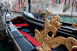 Close up of ornate gold decoration on gondola  in Venice Italy