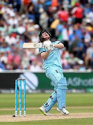 England's Eoin Morgan hits the ball in the air before being caught by India's Kedar Jadhav, bowled by Mohammed Shami, during the ICC Cricket World Cup group stage match at Edgbaston, Birmingham.