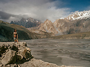 Passu area, in upper Hunza, and the Cathedral peak in the distance. People and places of the Hunza Valley, in the heart of the Karakoram mountain Range, North Pakistan.