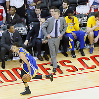 23 May 2015: Golden State Warriors guard Stephen Curry (30) brings the ball up court along the Golden State Warriors bench passing by Golden State Warriors head coach Steve Kerr during the Golden State Warriors 115-80 victory over the Houston Rockets, in game 3 of the Western Conference finals, at the Toyota Center, Houston, Texas, USA.