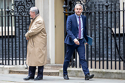 """© Licensed to London News Pictures. 13/03/2019. London, UK. Attorney General Geoffrey Cox QC (L) and Secretary of State for Exiting the European Union Stephen Barclay (R) leave 10 Downing Street after a meeting of the Cabinet. MPs will vote on whether to remove the option of a """"no deal"""" departure from the EU today, after Prine Minister Theresa May's proposed deal was defeated for a second time last night. Photo credit: Rob Pinney/LNP"""