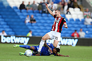 Paul Coutts of Sheffield Utd is fouled by Cardiff's Nathaniel Mendez-Laing. EFL Skybet championship match, Cardiff city v Sheffield Utd at the Cardiff City Stadium in Cardiff, South Wales on Tuesday 15th August 2017.<br /> pic by Andrew Orchard, Andrew Orchard sports photography.
