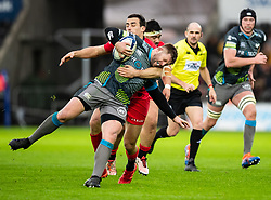 Scott Otten of Ospreys is tackled by Alex Lozowski of Saracens<br /> <br /> Photographer Simon King/Replay Images<br /> <br /> European Rugby Champions Cup Round 5 - Ospreys v Saracens - Saturday 11th January 2020 - Liberty Stadium - Swansea<br /> <br /> World Copyright © Replay Images . All rights reserved. info@replayimages.co.uk - http://replayimages.co.uk