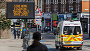 Information signs are given over to warnings to stay at home or only travel if essential, as people continue to get out in Balham. The 'lockdown' continues in Clapham - Coronavirus (Covid 19) outbreak in London.