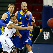 Besiktas's Curtis Jerrells and BC Khimki MR's James Augustine (R), Zoran Planinic (L) during their Turkish Airlines Euroleague Basketball Top 16 Game 1 match Besiktas between BC Khimki MR at Abdi ipekci Arena in Istanbul, Turkey, Thursday, December 27, 2012. Photo by TURKPIX