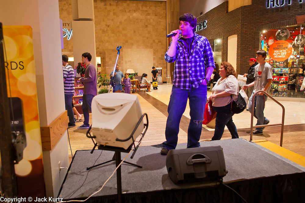 "25 NOVEMBER 2011 - PHOENIX, AZ:  David Schuberth (CQ) from Chicago, sings karaoke at Paradise Valley Mall Friday. ""Black Friday,"" the unofficial start of the holiday shopping season started even earlier than normal. Many stores, including Target and Best Buy, opened at midnight.    Photo by Jack Kurtz"