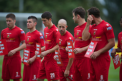 LLANELLI, WALES - Saturday, September 15, 2012: Llanelli players with 'Show Racism The Red Card' banners during the Welsh Premier League match against Newtown at Stebonheath Park. (Pic by David Rawcliffe/Propaganda)