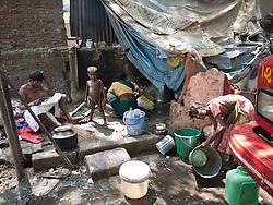 Family outside their shanty shack, Mumbai