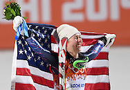 United States' Mikaela Shiffrin holds the American flag during a flower ceremony for the ladies' slalom at the Sochi 2014 Winter Olympics on February 21, 2014 in Krasnaya Polyana, Russia. Shiffrin won a gold medal finishing with a combined time of 1:44.54 for her two runs.  (UPI)