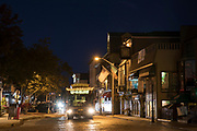 Nighttime street scene with tram in Newport, Rhode Island, USA