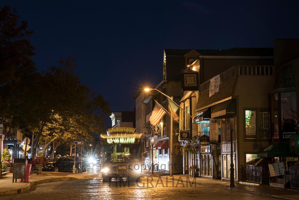 Nighttime street scene with tram in Newport, Rhode Island, USA