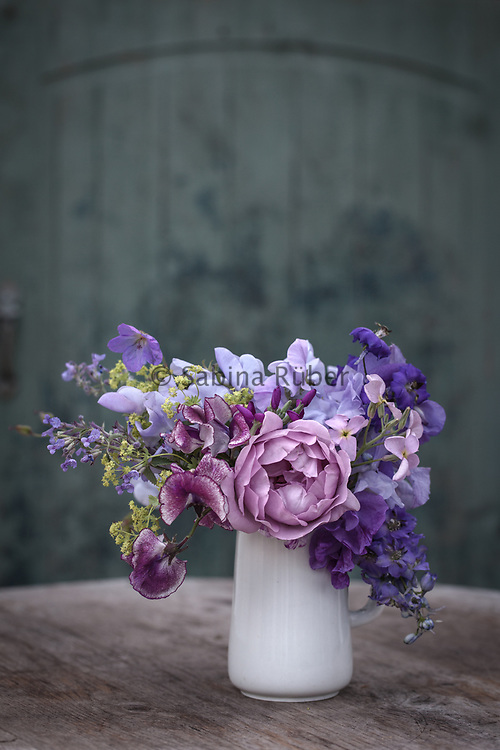 Pale blue and lilac early Summer flower arrangement with Delphinium, Rosa Harry Edland, Sweet peas and Matthiola