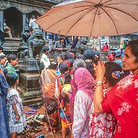 Hindu celebrants gather amongst pagodas to celebrate Krishna's birthday at the temple square in Patan Nepal, 1996.