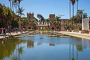 An Airplane Flies Over The Casa de Balboa and Reflection Pool of Balboa Park