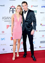 Lilly Lueesse (left) and Huw Mitchell attending the 8th Annual Asian Awards held at the Hilton Hotel, Park Lane, London.