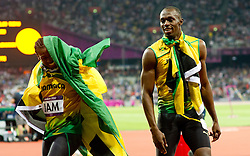 © Licensed to London News Pictures. 11/08/2012. London,UK. Usain Bolt, Yohan Blake, Nesta Carter and Michael Frater of Jamaica new World Record after Jamaica won the men's 4x100m final at the London 2012 Olympic Games Athletics, Track and Field events at the Olympic Stadium, London, Britain, 11 August 2012..  Photo credit : Bogdan Maran/LNP/BPA