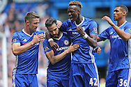 Cesc Fabregas of Chelsea (2nd left) celebrates after scoring from a penalty to make it 1-0 with Gary Cahill of Chelsea, Tammy Abraham of Chelsea and Ruben Loftus-Cheek of Chelsea. Barclays Premier league match, Chelsea v Leicester city at Stamford Bridge in London on Sunday 15th May 2016.<br /> pic by John Patrick Fletcher, Andrew Orchard sports photography.