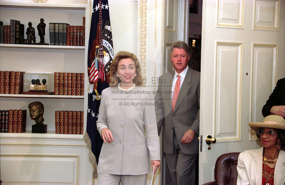 US President Bill Clinton and First Lady Hillary Clinton walk into the Oval Office of the White House for the weekly radio address on Social Security July 29, 1995 in Washington, DC.