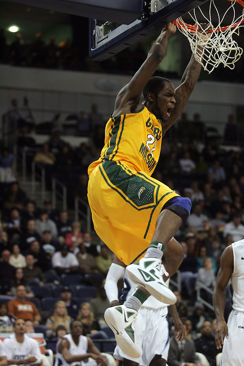 Jan 5, 2012; Norfolk, VA, USA; George Mason Patriots forward Mike Morrison (22) reacts after dunking the ball against the Old Dominion Monarchs at the Ted Constant Convocation Center. Mandatory Credit: Peter Casey-US PRESSWIRE