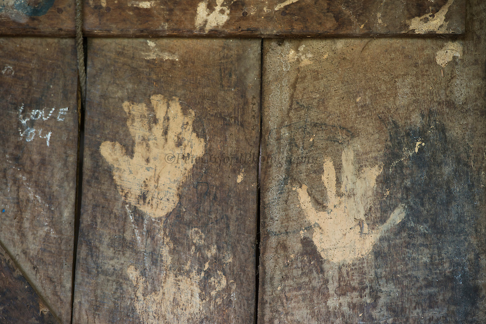 Konyak Naga door with handprints<br /> Konyak Naga headhunting Tribe<br /> Mon district<br /> Nagaland,  ne India