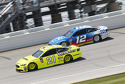 July 1, 2018 - Joliet, Illinois, United States of America - Paul Menard (21) and Ryan Blaney (12) battle for position during the Overton's 400 at Chicagoland Speedway in Joliet, Illinois  (Credit Image: © Justin R. Noe Asp Inc/ASP via ZUMA Wire)