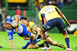 Cape Town. 160320. Brumbies fans from South Africa cheer during their Super 14 rugby match against the Brumbies from Australia in Cape Town, South Africa, 26 February 2010. The Brumbies defeated the Stormers 19-17. Juan De Jongh is tackled. pic PHANDO_JIKELO