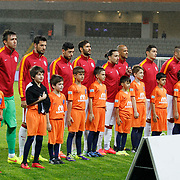 Galatasaray's players during their Turkish Super League soccer match Istanbul Basaksehir between Galatasaray at the Basaksehir Fatih Terim Arena at Basaksehir in Istanbul Turkey on Sunday, 26 October 2014. Photo by Aykut AKICI/TURKPIX