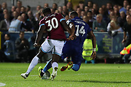 AFC Wimbledon midfielder Liam Trotter (14) battles for possession with West Ham United midfielder Michail Antonio (30) during the EFL Carabao Cup 2nd round match between AFC Wimbledon and West Ham United at the Cherry Red Records Stadium, Kingston, England on 28 August 2018.