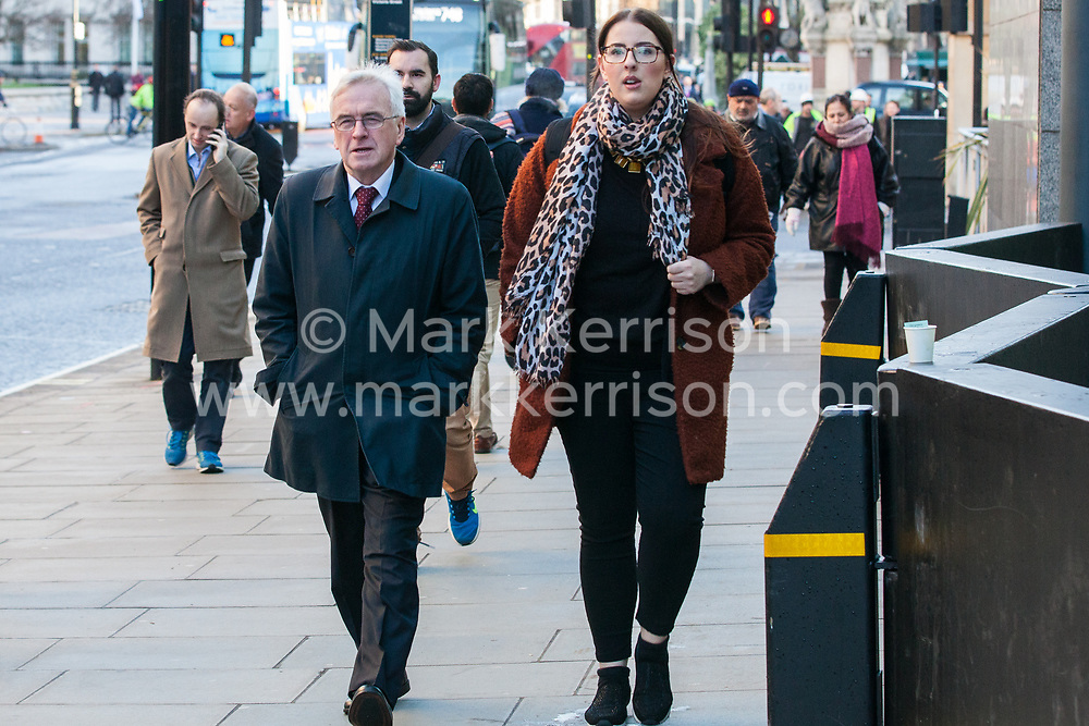 London, UK. 22nd January, 2019. Shadow Chancellor John McDonnell and Shadow Minister for Business, Energy and Industrial Strategy (BEIS) Laura Pidcock show solidarity for support staff at the BEIS represented by the Public and Commercial Services (PCS) union on the picket line after beginning a strike for the London Living Wage of £10.55 per hour and parity of sick pay and annual leave allowance with civil servants. The strike is being coordinated with receptionists, security staff and cleaners at the Ministry of Justice (MoJ) represented by the United Voices of the World (UVW) trade union.