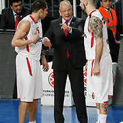 Olympiacos's coach Dusan Ivkovic (C) during their Turkish Airlines Euroleague Basketball Top 16 Group E Game 4 match Anadolu Efes between Olympiacos at Sinan Erdem Arena in Istanbul, Turkey, Wednesday, February 08, 2012. Photo by TURKPIX