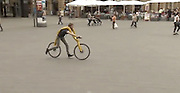 "runaround: The 'Flintstones' bicycle with no pedals or saddle<br /> <br /> It is a design that is sure to turn heads around town<br /> German designers have revealed a bizarre bicycle with no pedals.<br /> Instead, riders are strapped into a harness and move by walking or running<br /> <br /> Called the Fliz, it needs the user to build up speed by running and then lifting their legs to settle on foot rests at the hub of the rear wheel.<br /> Momentum then sends the rider and bike on their way, a little like cartoon stone age man Fred Flintstone's car.<br /> <br /> The bike, created by German designers Tom Hambrock and Juri Spetter, is fixed to the rider with a belt system suspended from the machine's frame under which the rider is fixed into pace.<br /> The bike is an entry into the annual James Dyson Award for technology , innovation and design open to international students and founded by the Dyson vacuum cleaner inventor.<br /> <br /> <br /> FLIZ comes from the German word ""flitzen"" and means speeding... with your feet.<br /> The concept is to provide healthy, ecological mobility in overcrowded urban spaces.<br /> The frame has a five point belt which is said, despite appearances, to provide a comfortable, ergonomic ride between running and biking. <br /> The belt replaces the saddle and adjusts your position. <br /> The inspiration was the world's first personal transport device , a two-wheeled frame which resembled a modern day cycle but without pedals.<br /> It was built by German inventor Karl Drais and unveiled in 1817.<br /> Known as a velocipede , the student team behind the FLIZ wanted to revive that principle but making it more modern with additional benefits.<br /> The team even tested a replica of the Drais machine to pinpoint it's failings such as th unsafe steering and over large seat.<br /> The FLIZ prototype made of wood and tension belts has been tested.<br /> Entries in the Dyson award compete for a £10,000 top prize.<br /> Hambrock and Spetter have already won a Merit Award at the International Cycle Show in Taipei earlier this year.<br /> ©Fliz/Exclusivepix"