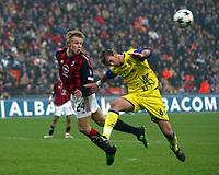 Milano 9/3/2003<br />Milan - Chievo 0-0<br />Martin Laursen anticipa Nicola Legrottaglie