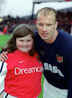 Dennis Bergkamp with the Arsenal mascot. Arsenal v Derby County. FA Premiership 11/11/2000. Credit: Colorsport.