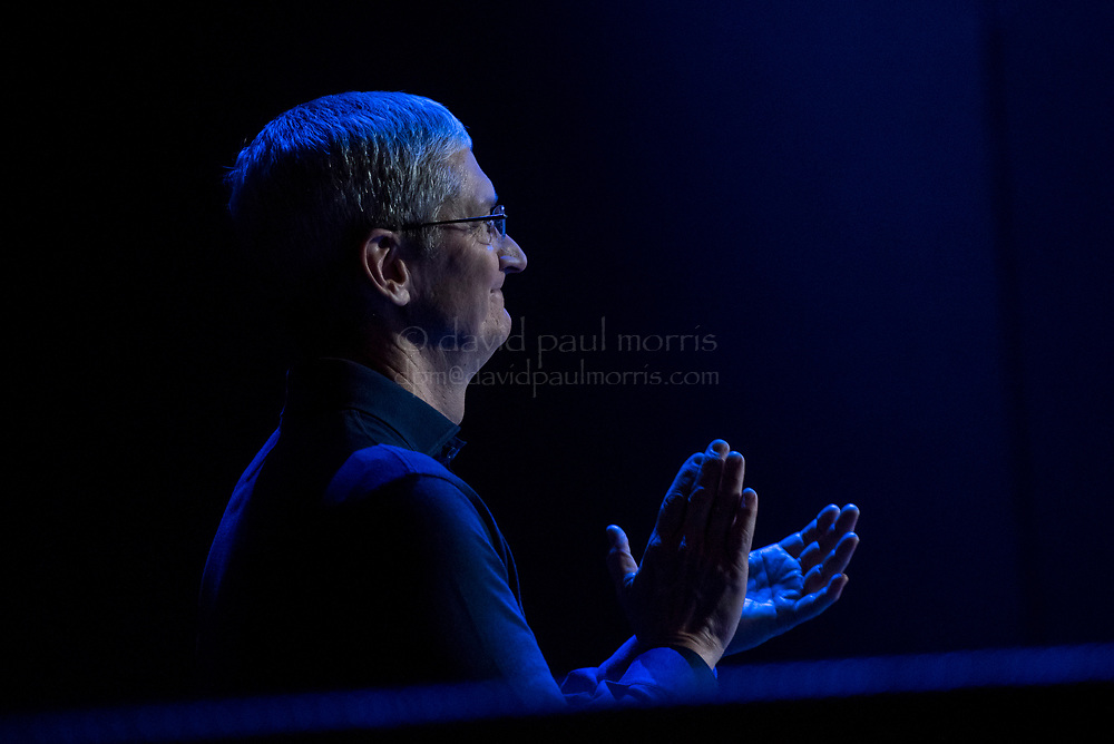 Tim Cook, chief executive officer of Apple Inc., watches a presentation during the Apple World Wide Developers Conference (WWDC) in San Francisco, California, U.S., on Monday, June 8, 2015. Apple Inc., the maker of iPhones and iPads, will introduce software improvements for its computer and mobile devices as well as reveal new updates, including the introduction of a revamped streaming music service. Photographer: David Paul Morris/Bloomberg *** Local Caption *** Tim Cook