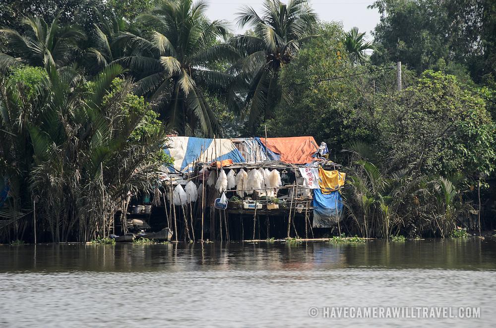 A fishing hut on stilts on the Saigon River in Ho Chi Minh City, Vietnam.